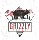 Old retro logo with bear grizzly. On mountains background.Vector vintage label royalty free illustration