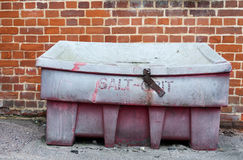 An old and retro looking red salt grit locked container outside. UK Stock Photos