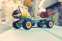 Old, retro metal roller skates with leather yellow straps royalty free stock images