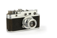 Old retro 35mm film camera. Isolated on white background Royalty Free Stock Photos