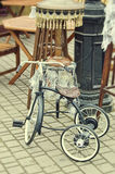 Old retro objects antique children's bicycle and floor lamp Stock Photo