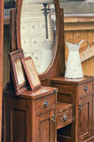 Old retro objects antique dressing table with mirror, framed photographs and jug Stock Photo