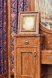 Old retro objects antique dressing table with mirror, framed photographs and screen Stock Image