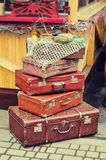 Old retro objects antique a lot of luggage valise suitcases. Vintage image retro style effect filter Royalty Free Stock Photography