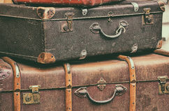 Old retro objects antique a lot of luggage valise. Suitcases, vintage image retro style effect filter Royalty Free Stock Photo