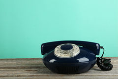Old retro phone on grey wooden background. Stock Photography