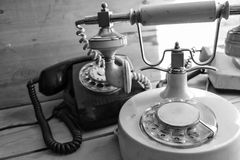Old retro phone. Real old phone. Telephone with handset white color and decoration stock images