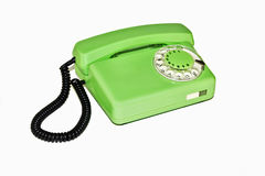 Old retro phone with rotary dial. On a white background is an old telephone with a rotary dialer royalty free stock image