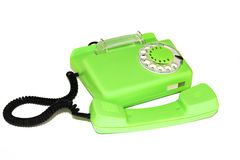 Old retro phone with a round dialer. On a white background is an old telephone with a round dialer royalty free stock image