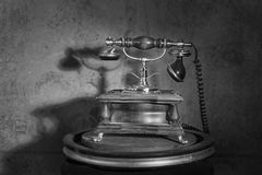 Old retro phone. On a stand royalty free stock photo