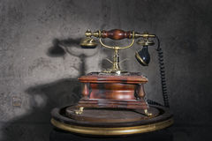 Old retro phone. On a stand royalty free stock photos