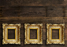 Old Retro Picture Frames on wooden wall Stock Photography