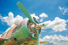 Old retro plane. On blue sky background Royalty Free Stock Photography