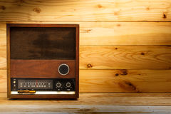 Old retro radio with light on table. Royalty Free Stock Photography