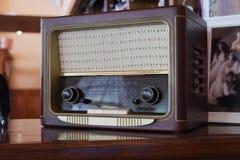 Old retro radio. On the table Stock Photo