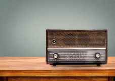 Old retro radio on table. With vintage green eye light background Royalty Free Stock Photo