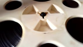 Old retro Reel Audio Recorder reels spinning. Rotation reel with tape on the video, audio tape recorder player. Closeup stock footage