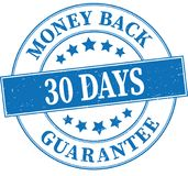 Blue money back gurantee 30 days grungy round rubber stamp illus. Old retro rubber stamp on white background Royalty Free Stock Photography