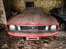 Old retro rusty car in village garage Stock Photo