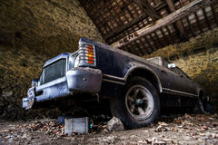 Old retro rusty car in village garage Royalty Free Stock Image