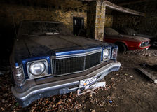 Old retro rusty car in village garage Stock Images