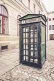 Old retro street public telephone booth Stock Photo