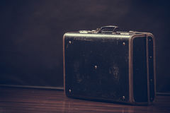 Old retro style suitcase on dark Stock Image