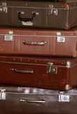 Old retro suitcases at a wall Royalty Free Stock Photos