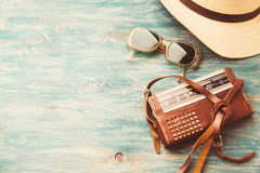 Old retro sunglasses and radio. Old retro sunglasses, radio and a hat on a wooden table Stock Photography