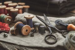 Free Old Retro Tailoring Scissors, Measuring Tape, Thimble, Wooden Spools Of Thread, Cutting Knife, Pin Cushion And Sewing Accessories. Royalty Free Stock Images - 161620429