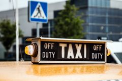 Old retro taxi on the streets Stock Photos