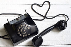 Old retro telephone with heart shape abstract Royalty Free Stock Photography