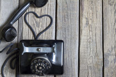 Old retro telephone with heart shape abstract Stock Photos