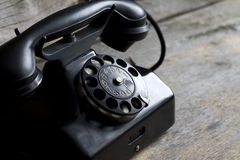 Old retro telephone on vintage boards Royalty Free Stock Photo