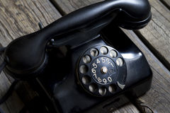 Old retro telephone on vintage boards Stock Image