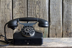 Old retro telephone on vintage boards Royalty Free Stock Images