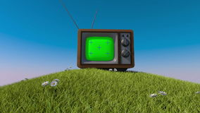 Old retro tv on a grassy hill. 3d animation. Tracking your content stock video