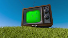 Old retro tv on a grassy hill. 3d animation. Tracking your content stock footage