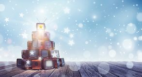 Old retro TV`s stacked like Christmas tree with star on top royalty free illustration