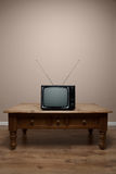 Old retro TV on table blank screen Stock Photos