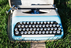 Old retro typewriter on the grass Stock Image