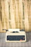 Old retro typewriter on table on wood background Stock Photo
