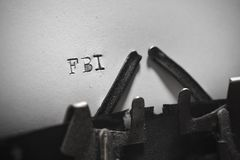 Old typewriter with the written text FBI. Old retro typewriter with the written text FBI Stock Image