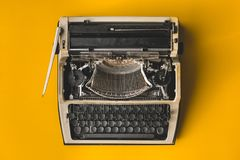 Old Retro Typewriter On A Yellow Background, Top View. Creative Royalty Free Stock Images