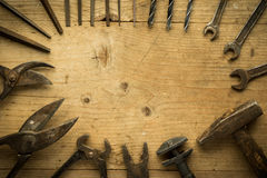 Old retro used tools on wooden table Royalty Free Stock Images