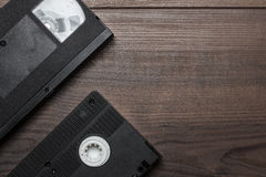 Old retro video tape on wooden background Royalty Free Stock Photo