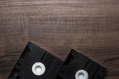 Old retro video tape on wooden background Royalty Free Stock Photos