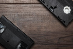 Old retro video tape on wooden background Stock Photos
