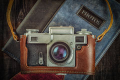 Old retro vintage camera on grunge wooden Royalty Free Stock Images