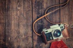 Old retro vintage camera on grunge wooden Royalty Free Stock Photo
